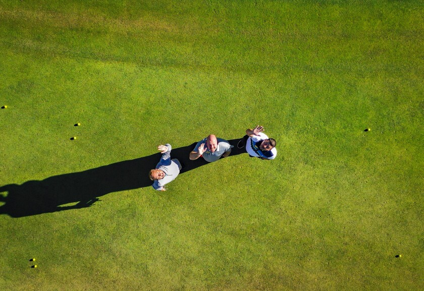 drone shot of golfers at Quarry Pines Golf Club