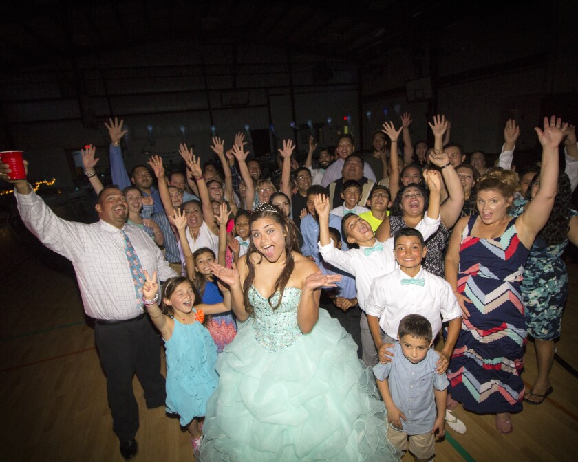 family and friends celebrating quinceanera at Orchard Valley Golf Course
