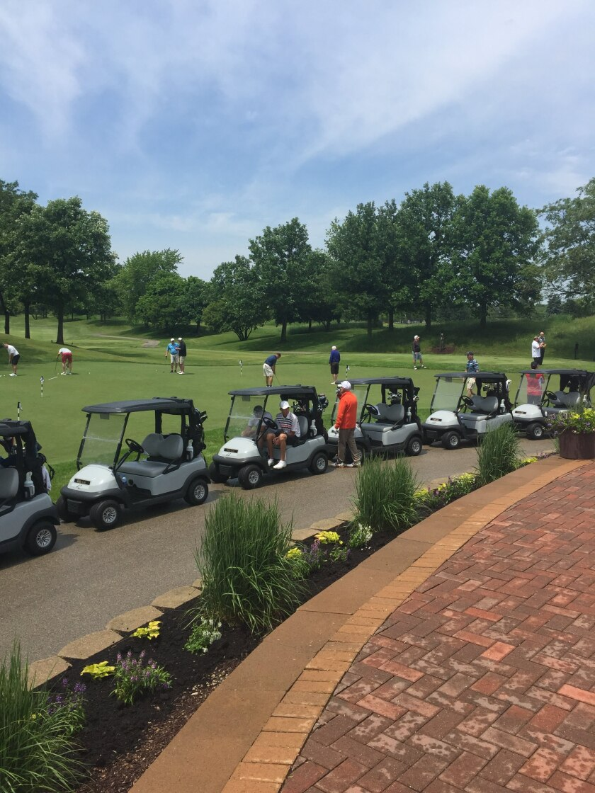 carts lined up for outing event at Orchard Valley Golf Course
