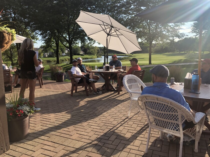 people dining on patio at Orchard Valley Golf Course