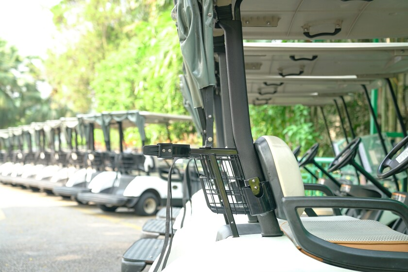 Golf carts parked outside a golf club