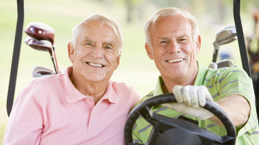 Two Senior Male Golfers in Cart
