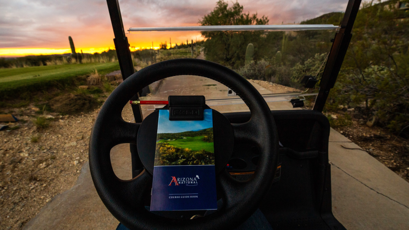 Arizona National Golf Club sunset sky view from golf cart with scorecard on wheel